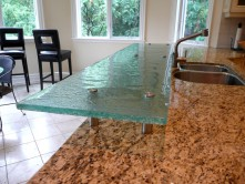 Raised glass bar countertop. Shown in textured glass with standoffs.