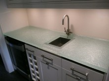 "Glass kitchen countertop shown with textured 1 1/2"" glass."