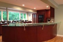 SAMPLE OF RAISED GLASS COUNTERTOP WITH STANDOFFS AND CUSTOM BRACKETS