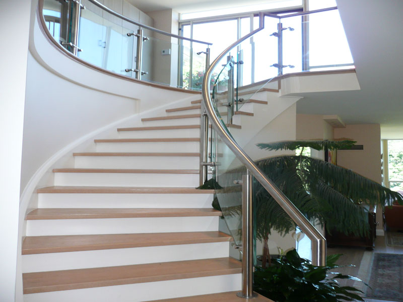 Glass railing with combination of stainless steel